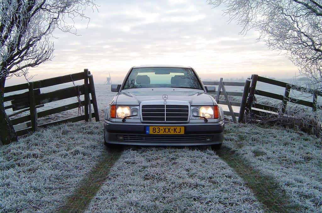 """A pre-1994 Euro-spec 500E with the European headlights and the big classic traditional Mercedes-Benz grill. 1992 and 1993 U.S. versions had slightly different headlights than their European brethren. European spec cars can be identified by their flush glass """"European style"""" headlamps and accompanying big headlight wiper blades."""