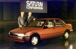 Roger Smith (left) with a Saturn prototype in 1984. Roger's lackluster leadership of GM helped set the stage for GM's spectacular bankruptcy decades later. Cars like the Saturn, Cimmeron, and Oldsmobile Diesel gave the imports an opportunity to gain market share.